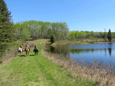 Horse riding at lake in Manitoba