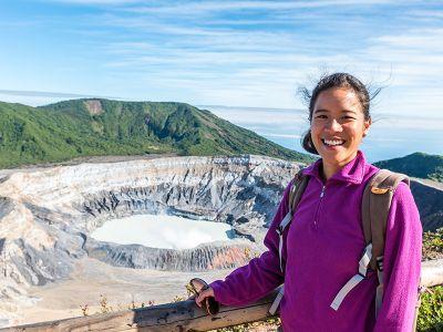 Intern poses in front of volcano caldera