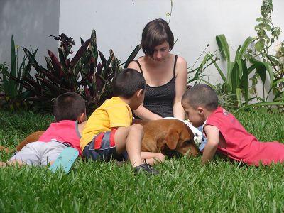 Volunteer plays with kid