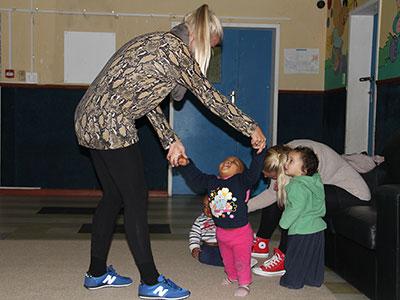 Volunteer plays with children
