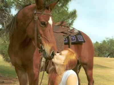 Farmstaynee kisses horse